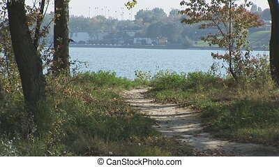 two athletes running near water - two athletes running on...