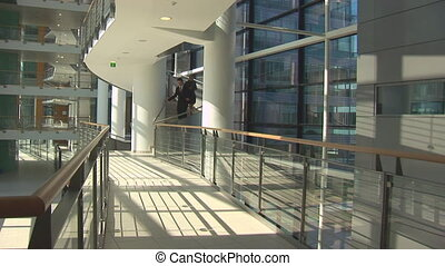 manager and secretary in a hurry in office building