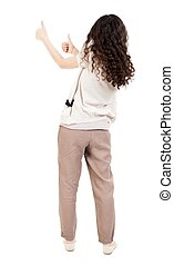 Back view of woman thumbs up. Rear view people collection....