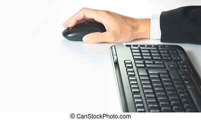 hand moving mouse with keyboard on white background
