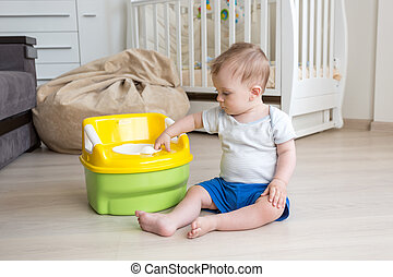 10 months old baby boy getting accustomed to using chamber...