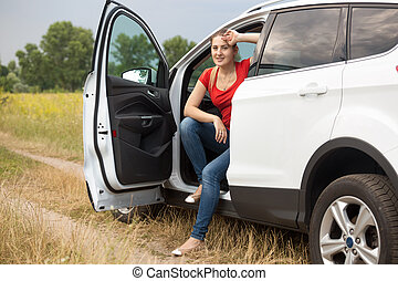 Toned image of beautiful woman got lost while driving car in...