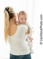 Portrait of beautiful woman with her 3 months old baby boy...