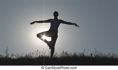 yoga in front of sun