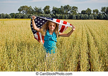 Freedom Run - Little girl running with American flag in...