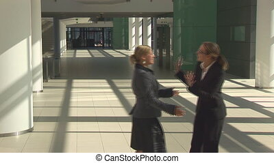 greeting female managers - female managers greeting, chating...