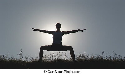 woman exercising in front of sun