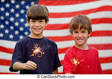 Boys With Sparklers - Boys at Twilight Holding Sparklers in...