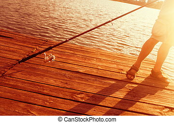 Relax fishing at sunset on summer - A man with a fishing rod...