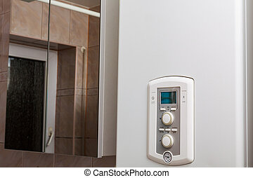 Control panel of DHW or central heating on combi boiler in restroom.