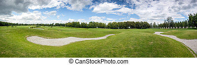 Beautiful panoramic shot of golf course at sunny day -...