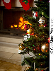 Background of decorated Christmas tree in front of burning...