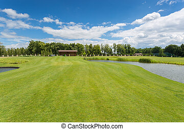 Beautiful golf course with perfect grass and water hindrance...