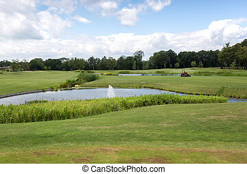 Beautiful pond on golf course at sunny day - Beautiful pond...