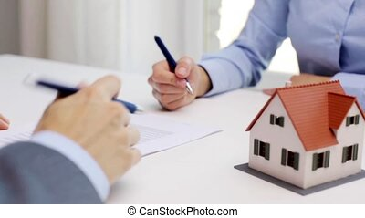 business partners with house model and contract - business,...