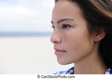 beautiful woman by the beach with copy space