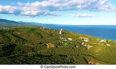 Aerial view on the beautiful landscape, sea, mountains, forest and blue sky.