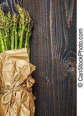 harvested asparagus on wooden - bundle of harvested fresh...