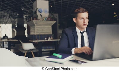 Businessman With Modern Laptop In Cafe - Young Man With...