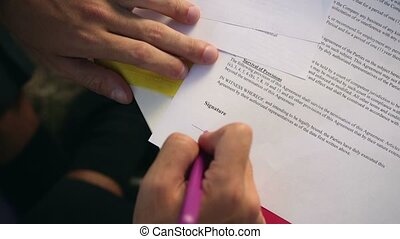 Businessman signing a contract - Closeup of businessman's...
