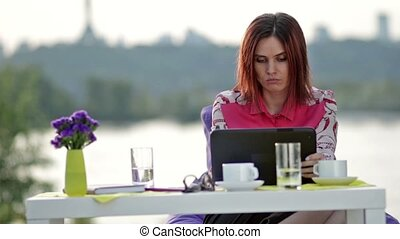 Businesswoman doing online shopping outdoors