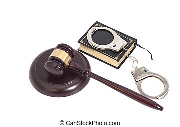 Judge gavel,Handcuffs and book on law isolated on white background