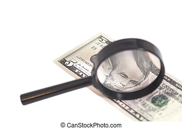 Five dollar bill with a magnifying glass isolated on white...
