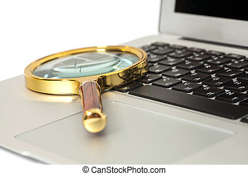 Laptop With Magnifying Glass on white