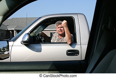 man showing road rage - man with fist in the air showing...