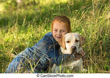 A little girl lies in the grass