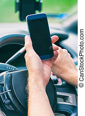 Man with smart phone in the car
