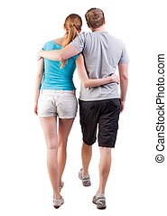 Back view of going young couple (man and woman). walking...