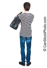 Back view of man in jeans with bag