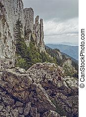 Piatra Mare Massif, Romania - Scenic view with steep...