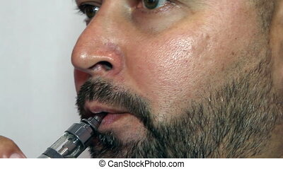 Respectable man smoking electronic cigarette close up
