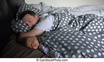Newborn Baby boy sleep with his father - Father sleeping...