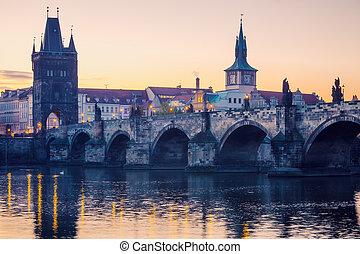 Prague city sunrise over Charles Bridge on Vltava river