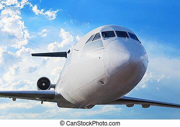 passenger plane in the blue sky - passenger plane in the...