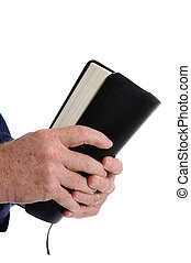 Missionary Holding Bible - Missionary man\'s hands clutch...