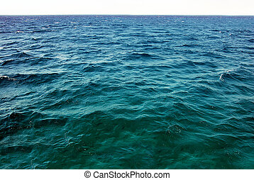 Natural sea water surface - natural greenish blue seawater...