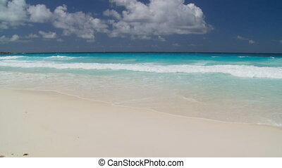 waves - turquoise ocean, whitecaps and sandy beach