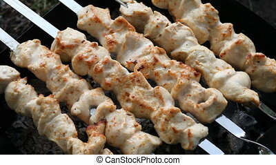 Barbecue skewers with meat on the brazier. Chicken shish...