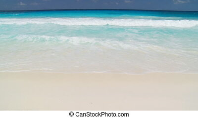 nice waves on sandy beach - inviting waves on sandy beach