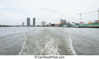 Boat travel on the Chao Phraya rive - Bangkok, Thailand -...