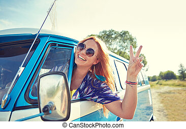smiling young hippie woman driving minivan car - summer...