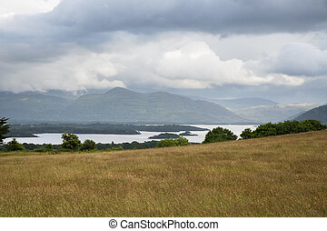view to lake and hills at connemara in ireland - nature and...