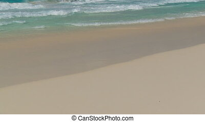waves touching sandy beach close