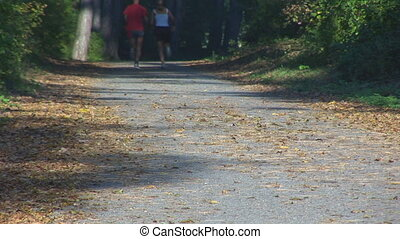 couple running up road, legs part II - couple running up...