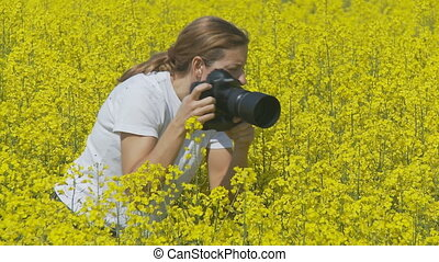 wildlife photographer wide - woman taking pictures in...