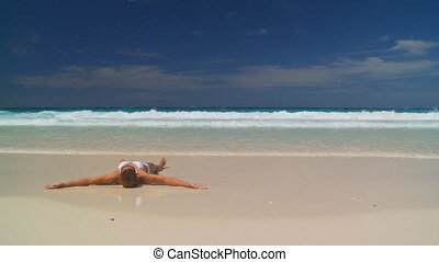 young woman stranded - young woman in white bikini stranded...